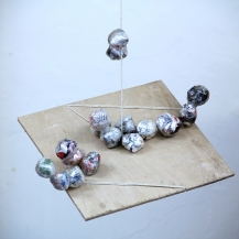 Study of light sculpture. 2014. newspaper and thread. Dimensions variable.