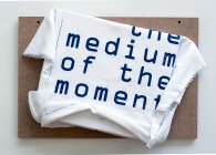 The Medium Of The Moment. 2016. timber and screen-printed T-shirt. 25cm x 30cm x 10cm.
