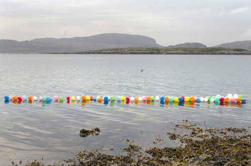 Untitled. 2016. Balloons and rope on water. Dimensions variable.