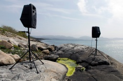 Photograph: Speakers playing music in landscape. Stokkøya, Norway.